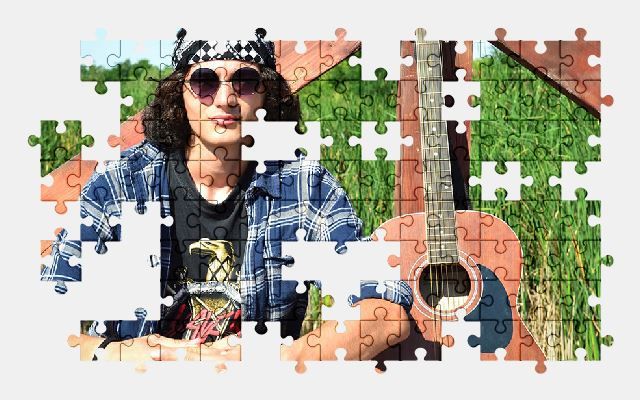 free jigsaw puzzle online rock,guitar,guy,music
